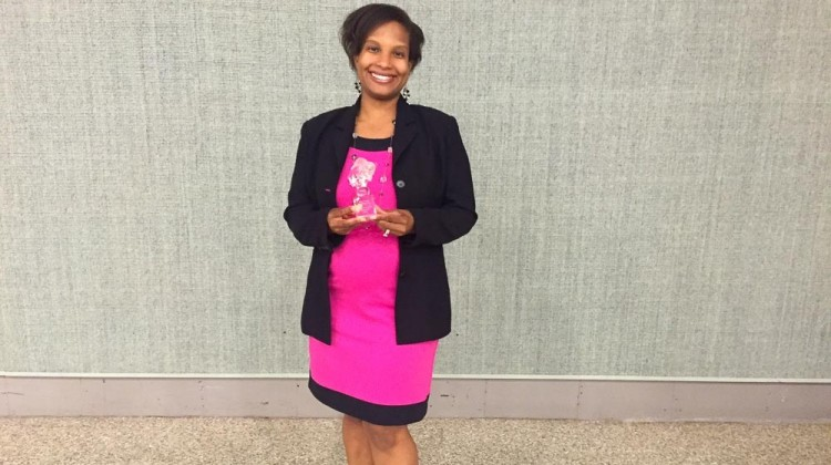 Marina holding the 2015 Small Business of the Year Award